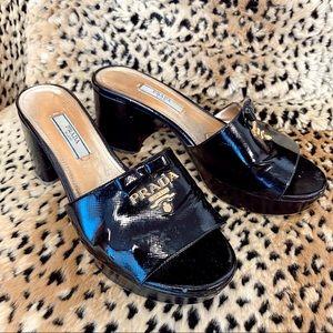 Prada black patent leather slip on platform mule sandal